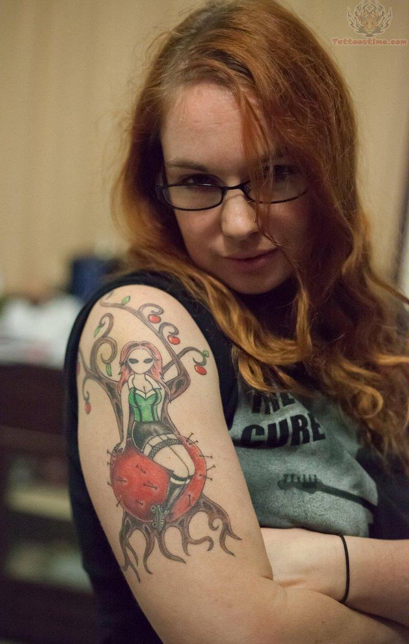 Girl on apple tree tattoo on arm
