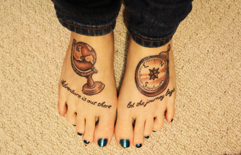 Globe compass tattoo on feet