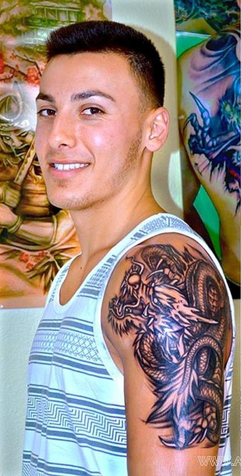 Glowing dragon tattoo on half sleeve