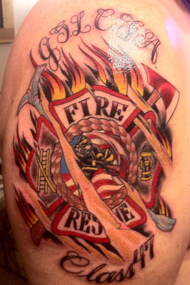 Glowing firefighter tattoo on shoulder