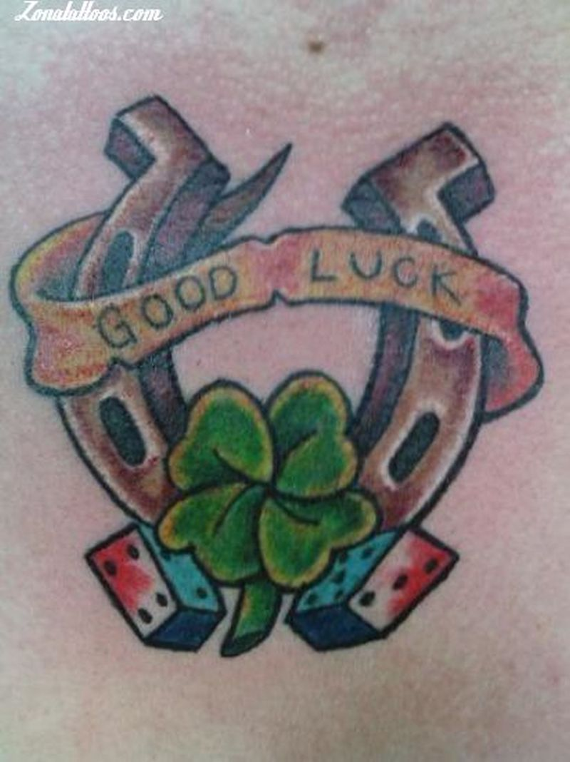 Good luck horseshoe n clover design tattoo