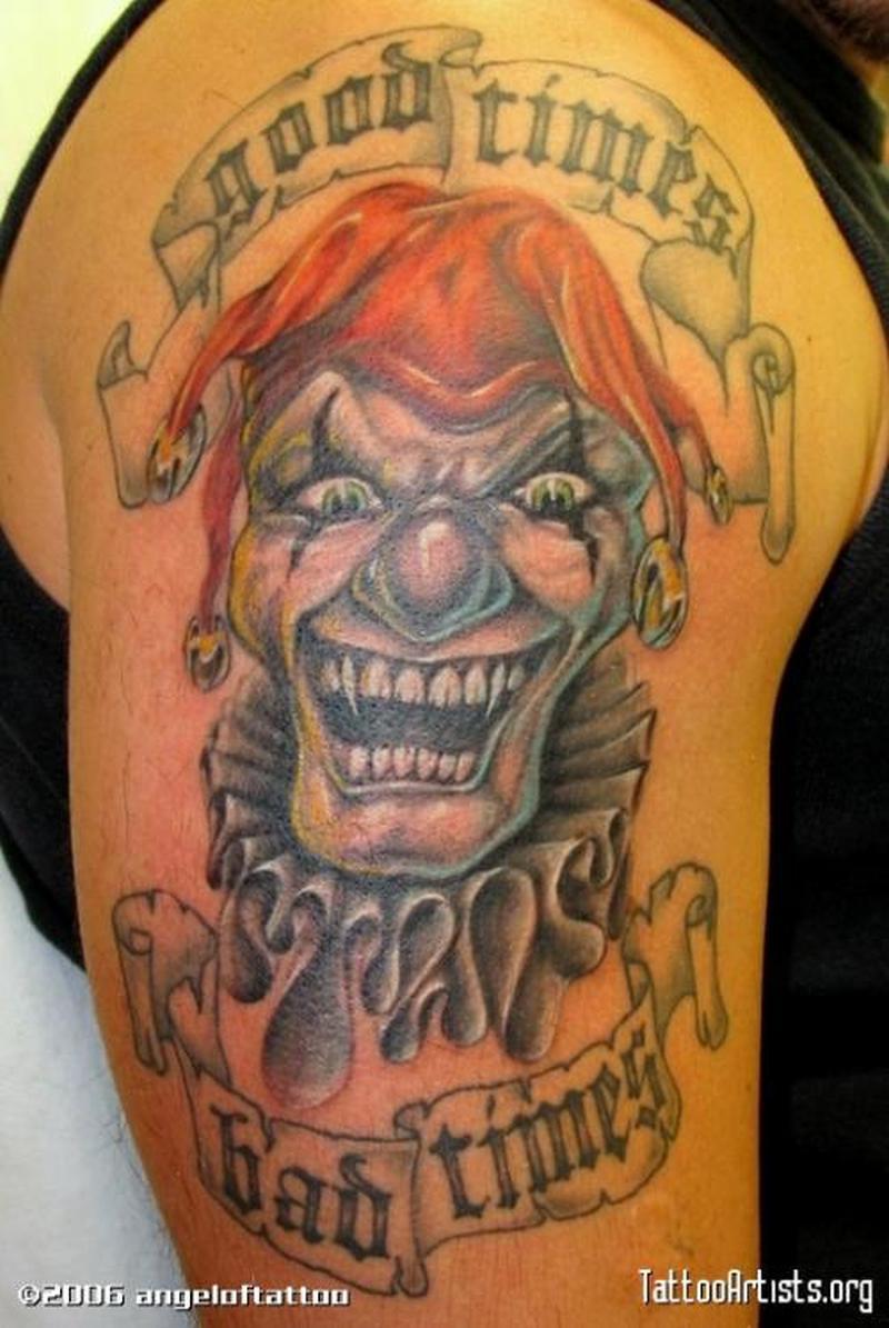 Good n bat times joker tattoo on upper arm