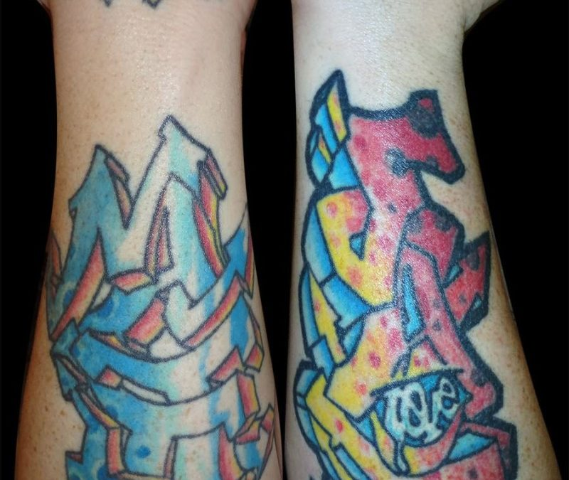Graffiti writing tattoo designs on forearms
