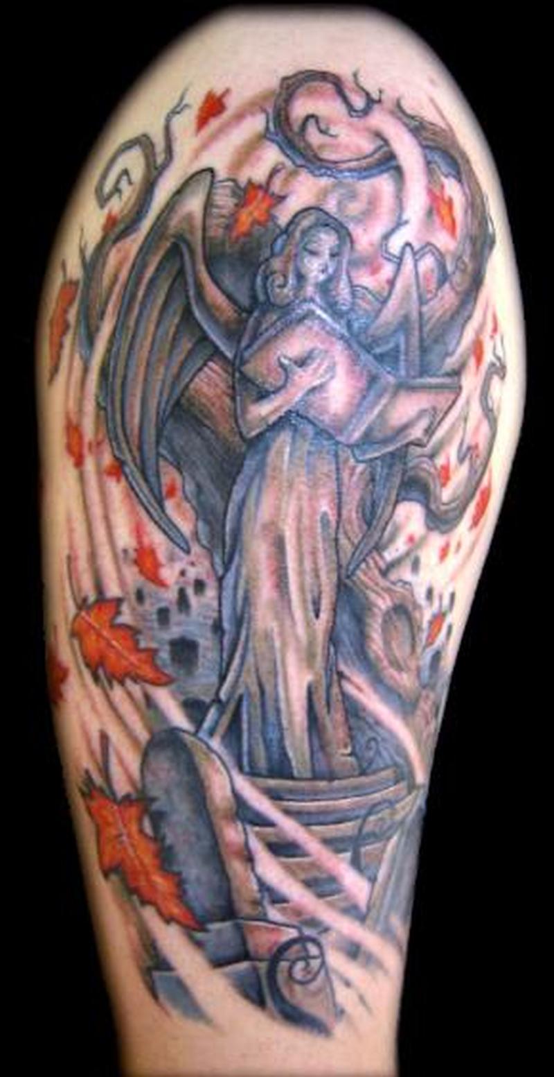 Graveyard angel on shoulder tattoo