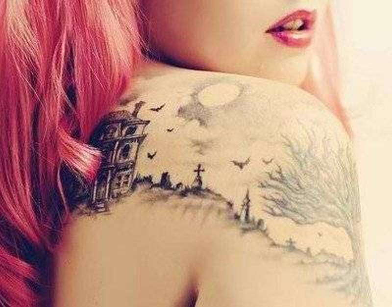 Graveyard tattoo design on back of shoulder