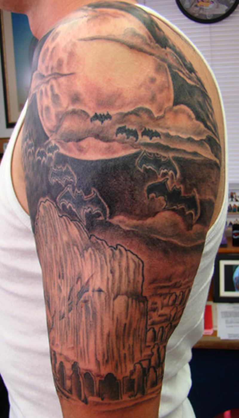 Graveyard tattoo design on shoulder