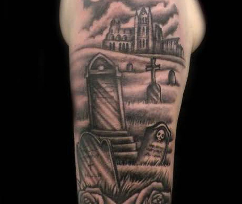 Graveyard tattoo design on the arm 3
