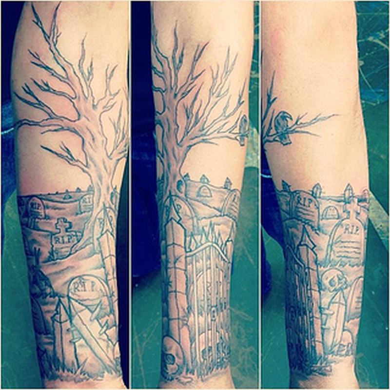 Graveyard tree tattoo design on arm