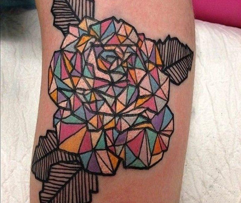 Great geometric coloured rose tattoo.