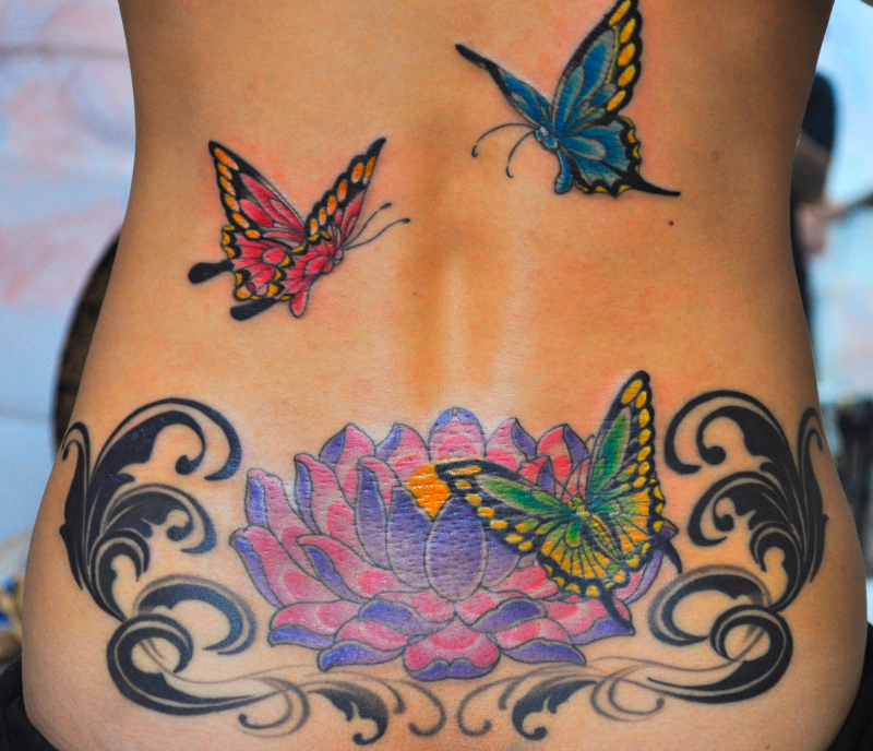 Great lotus flower n butterflies tattoo on back