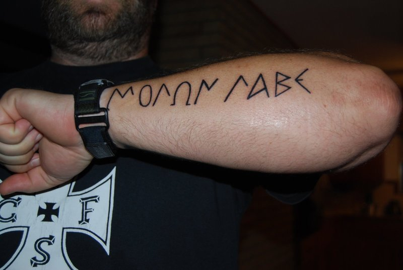 Greek alphabet tattoo on forearm