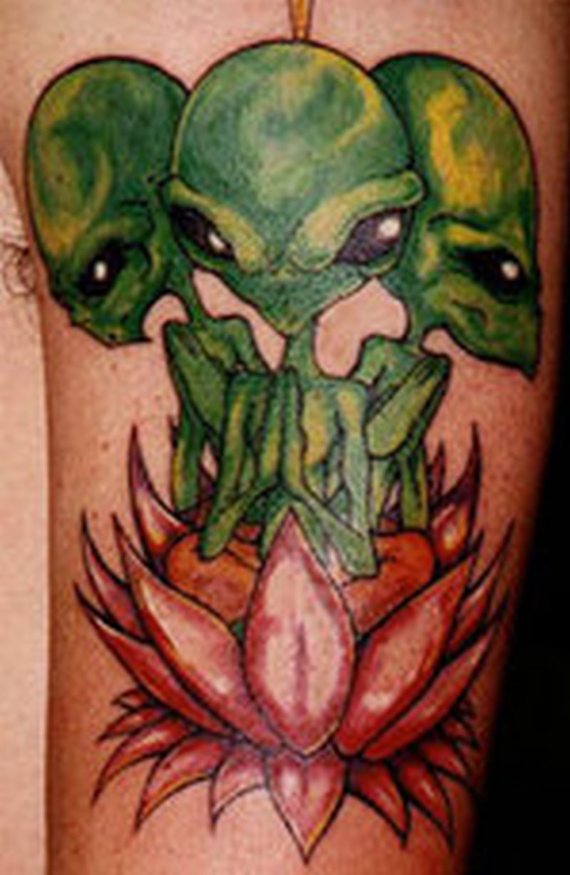 Green aliens and lotus tattoo