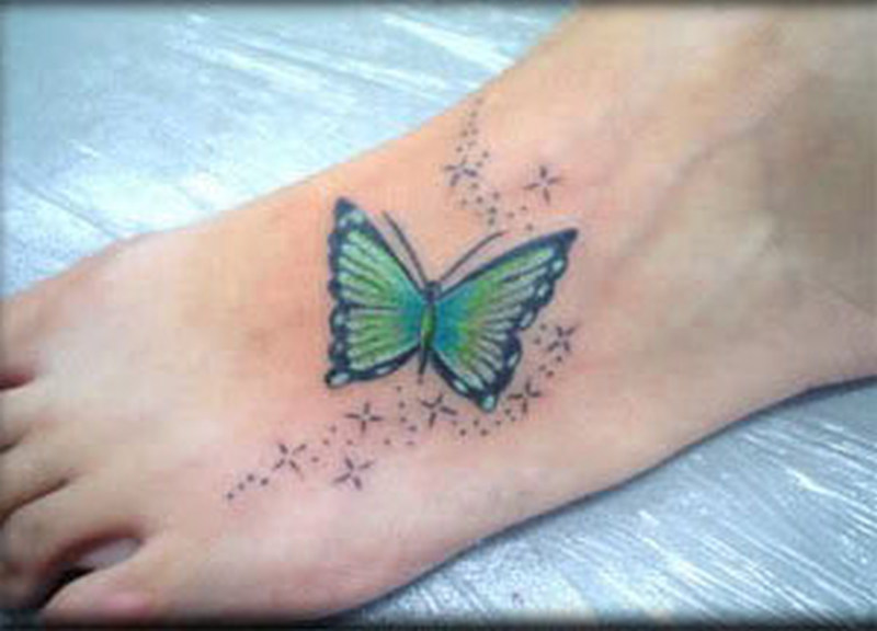green butterfly tattoo on foot tattoos book tattoos designs. Black Bedroom Furniture Sets. Home Design Ideas