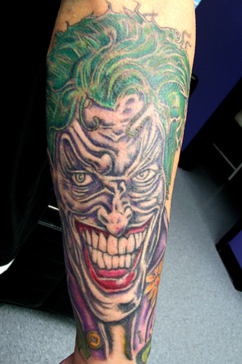Green hair joker tattoo on leg
