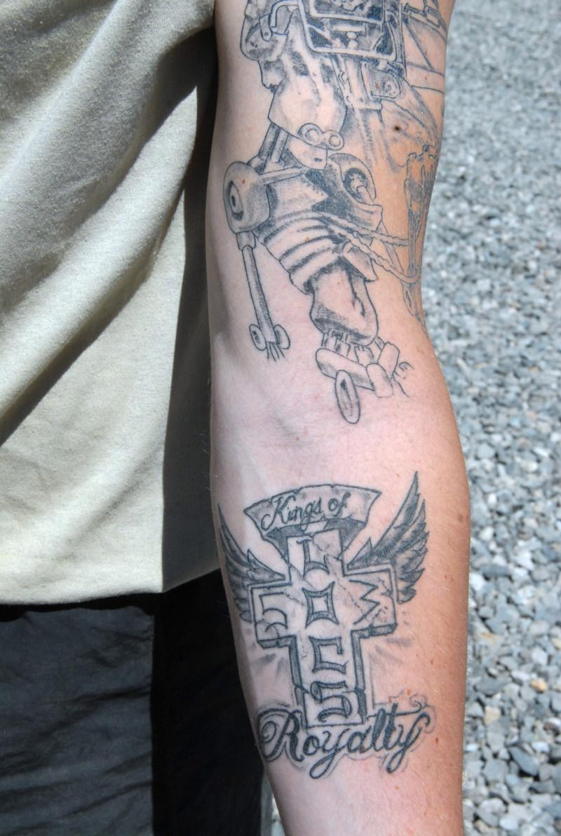 Grey ink army tattoo on arm