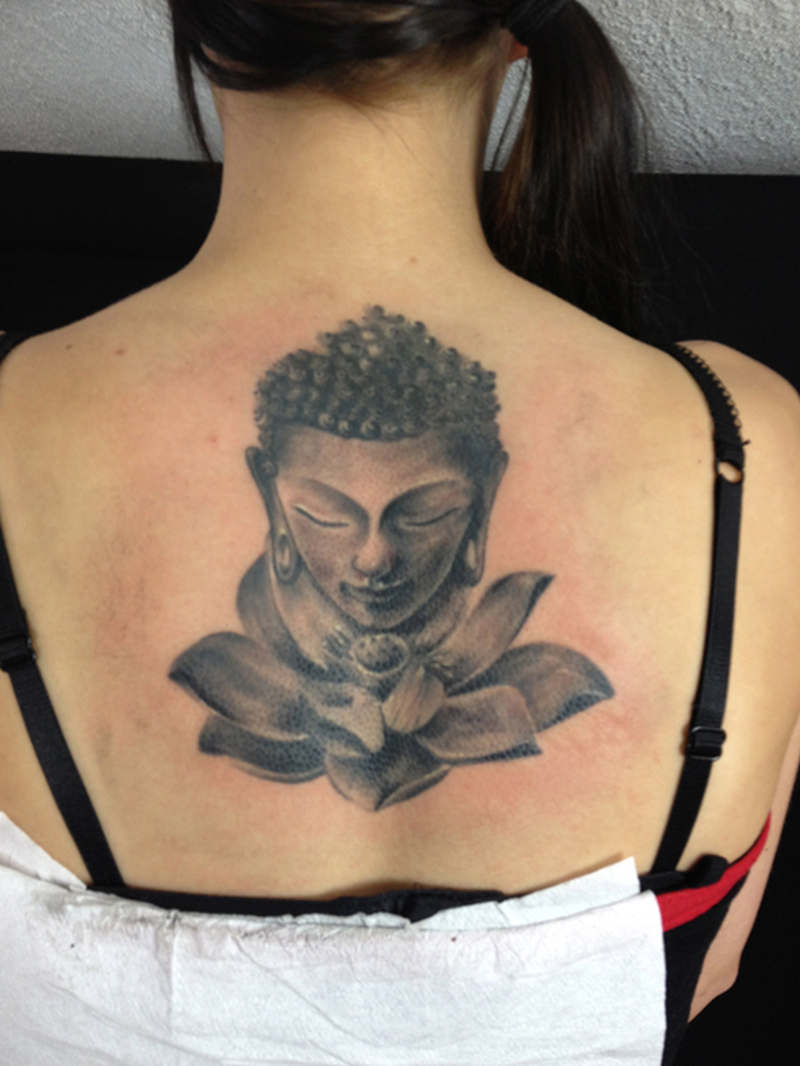 Grey ink buddha lotus tattoo on upper back
