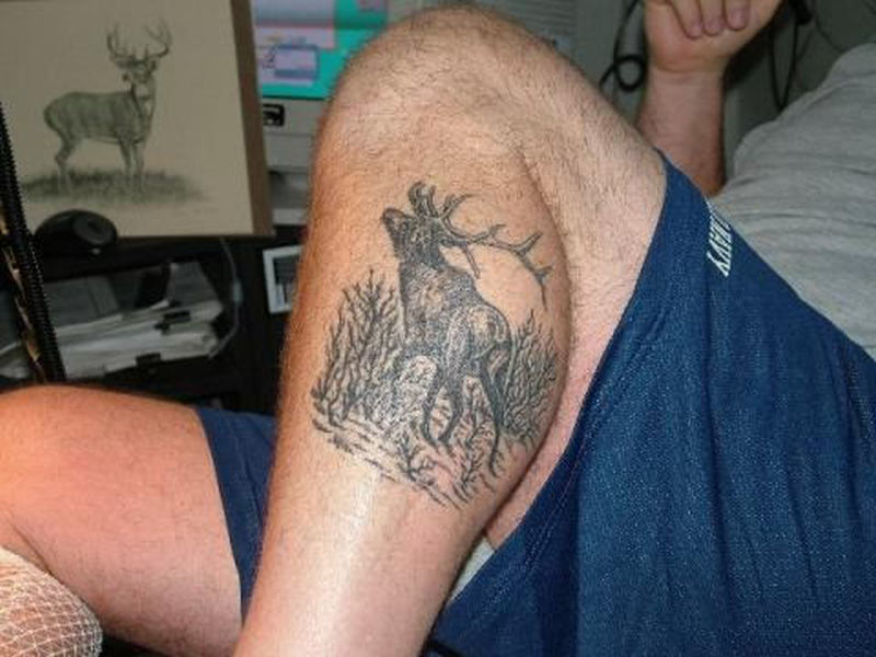 Grey ink deer tattoo on leg