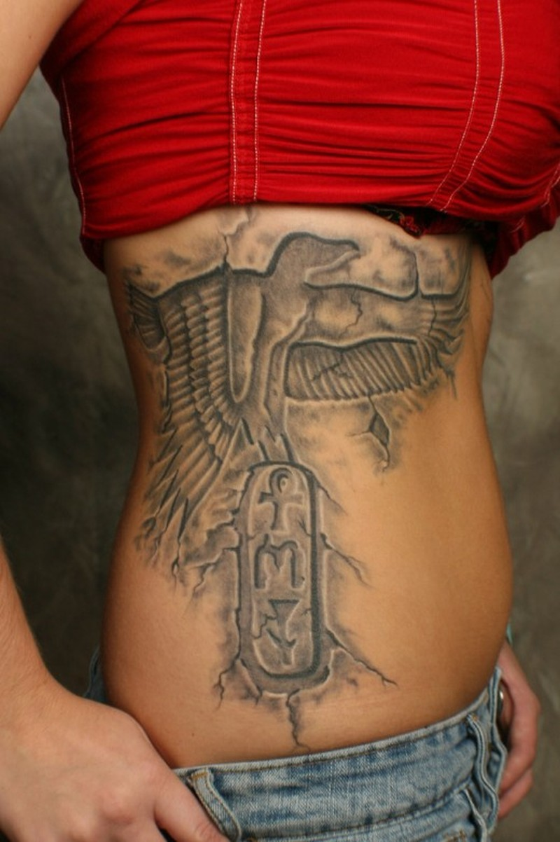 Grey ink egyptian tattoo on ribs for girls