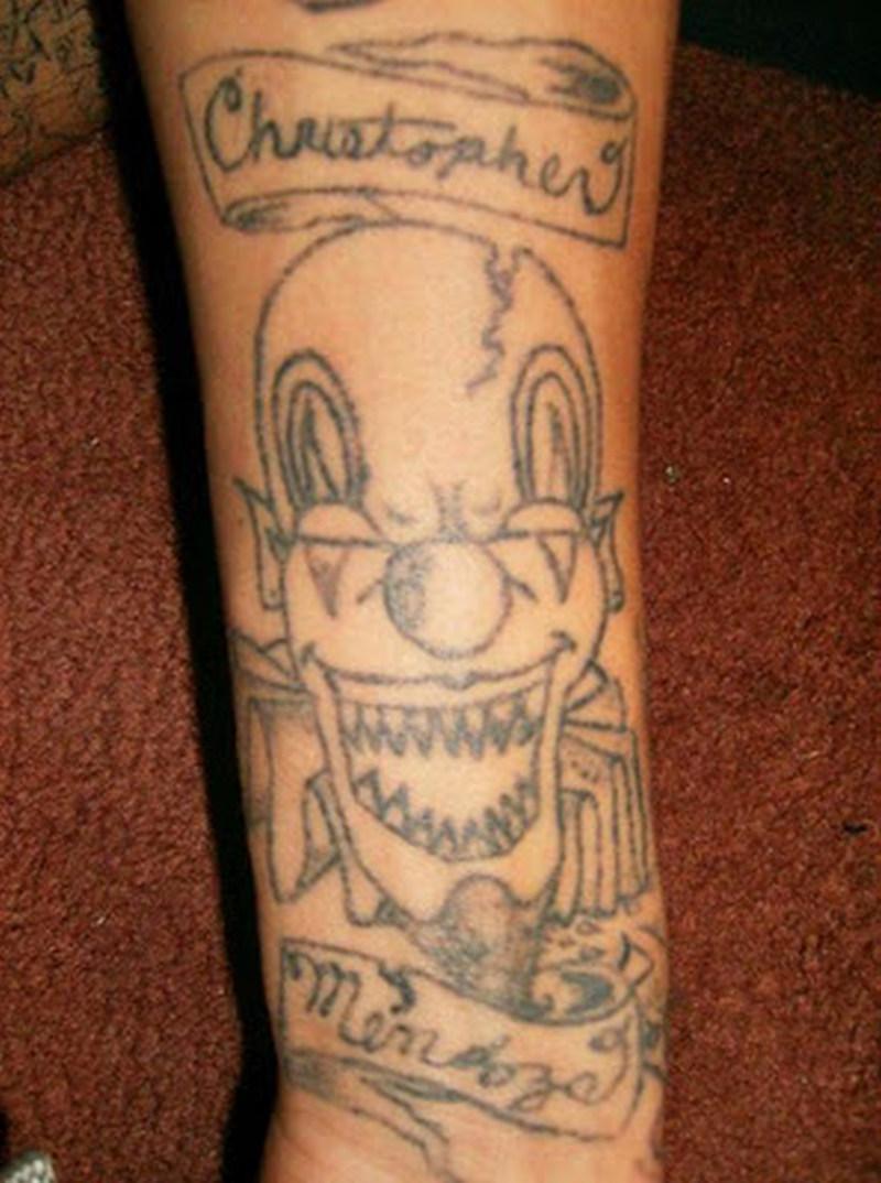 Grey ink funny clown tattoo