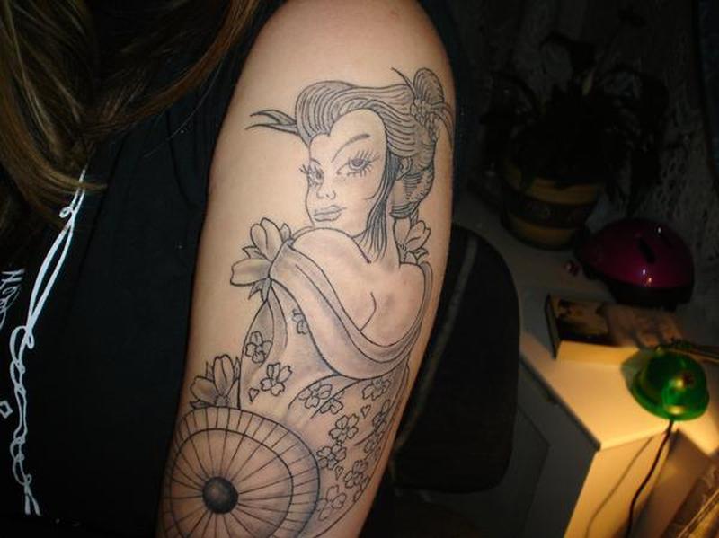Grey ink geisha tattoo on left arm