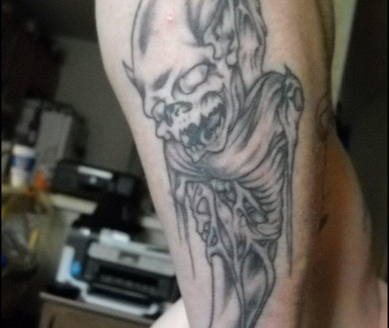 Grey ink horror tattoo design