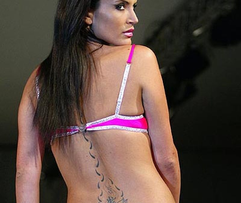 Grey ink lotus tattoo on back