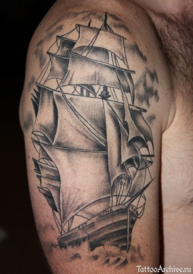 Grey ink pirate ship tattoo on half sleeve