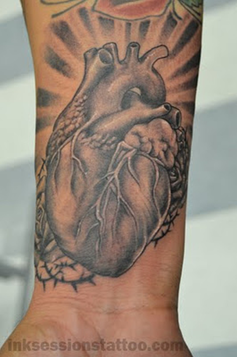 grey ink real heart tattoo on wrist tattoos book tattoos designs. Black Bedroom Furniture Sets. Home Design Ideas