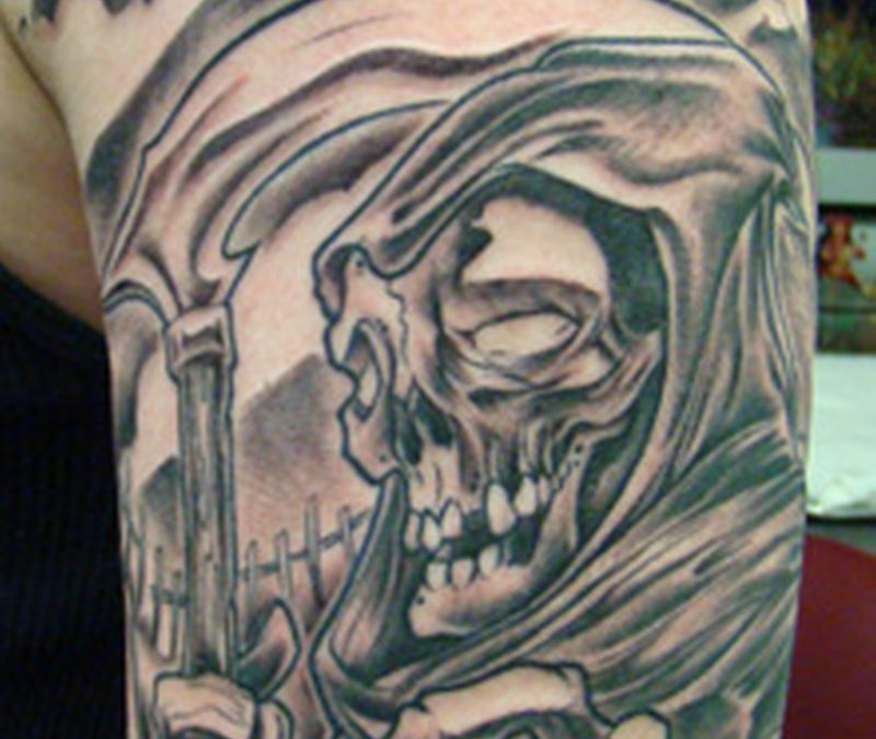 Grim reaper graveyard tattoo on sleeve