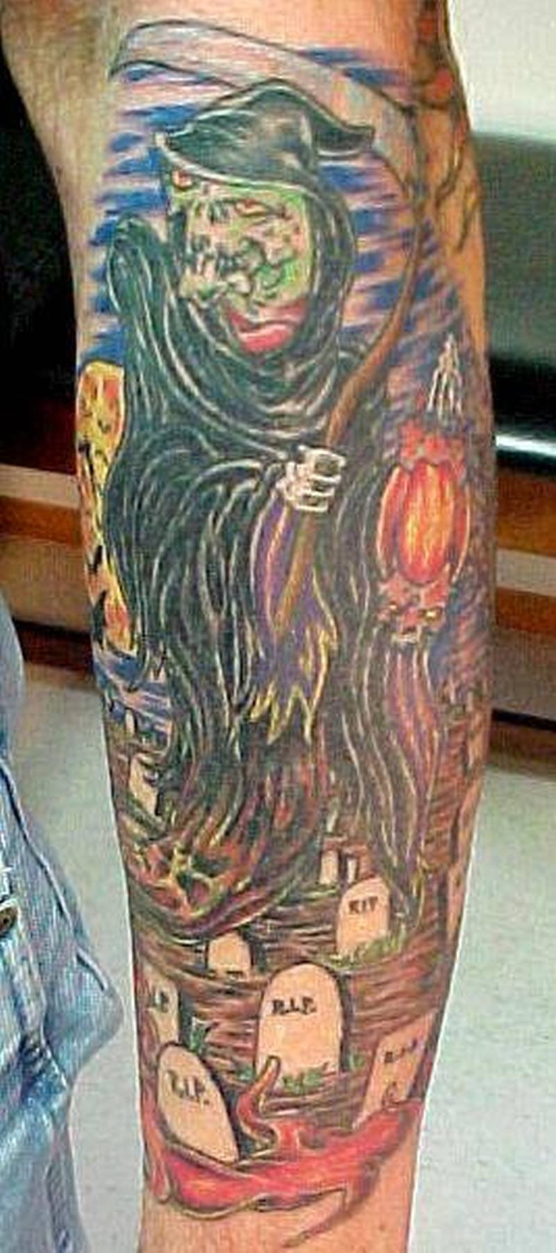Grim reaper in graveyard design tattoo