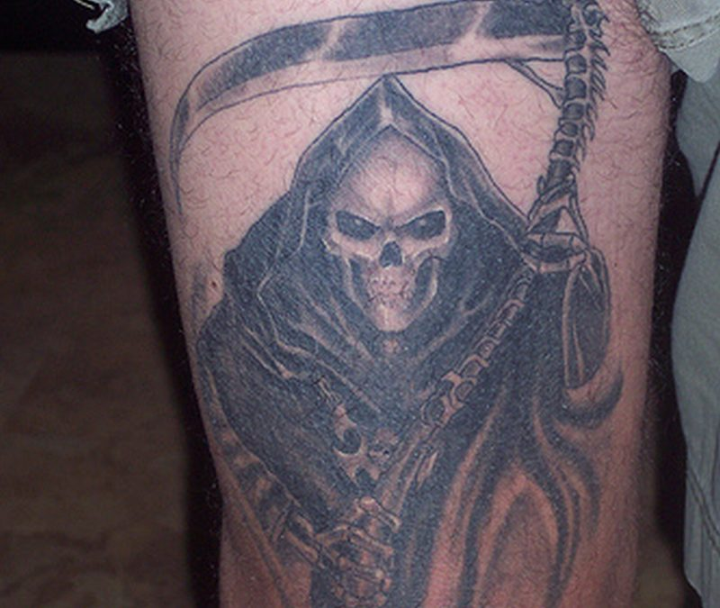 Grim reaper tattoo on thigh
