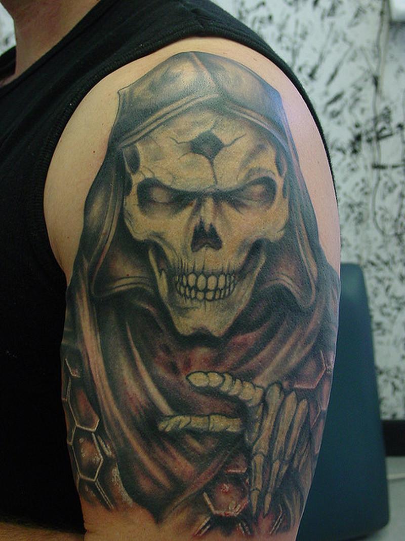 Grim reaper tattoo on upper arm
