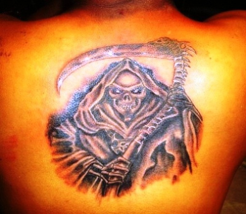 Grim reaper tattoo on upper back 2