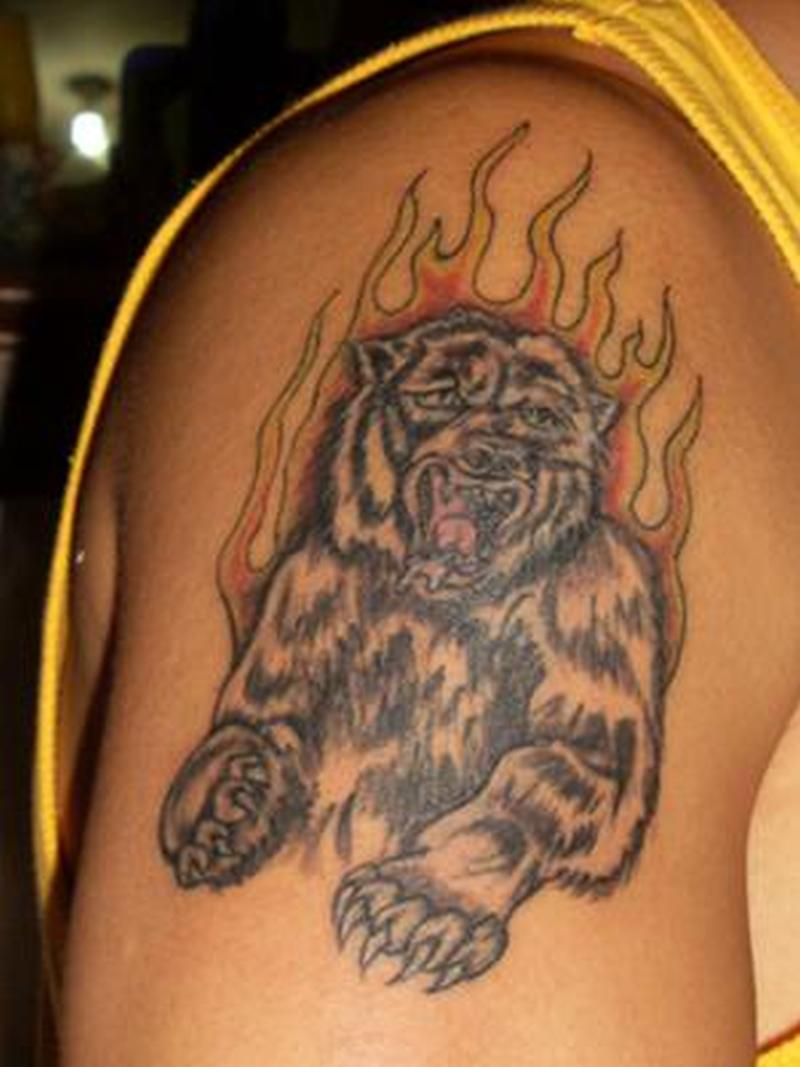 Grizzly bear tattoo in flame
