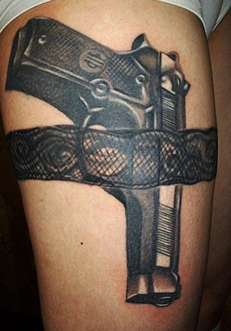 Gun in stoking thigh tatto tattoo