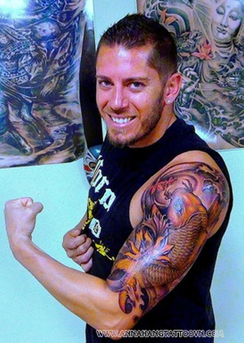 Guy with half sleeve fish tattoo design