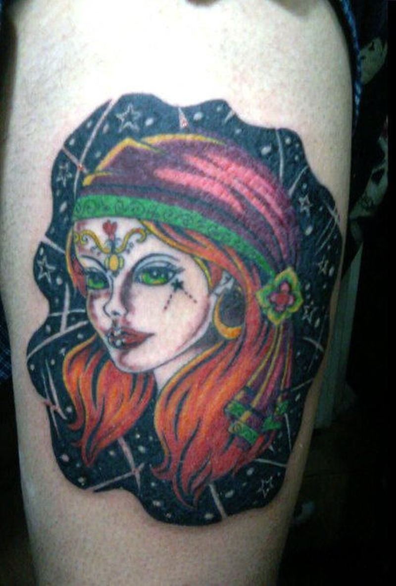 Gypsy girl tattoo on thigh
