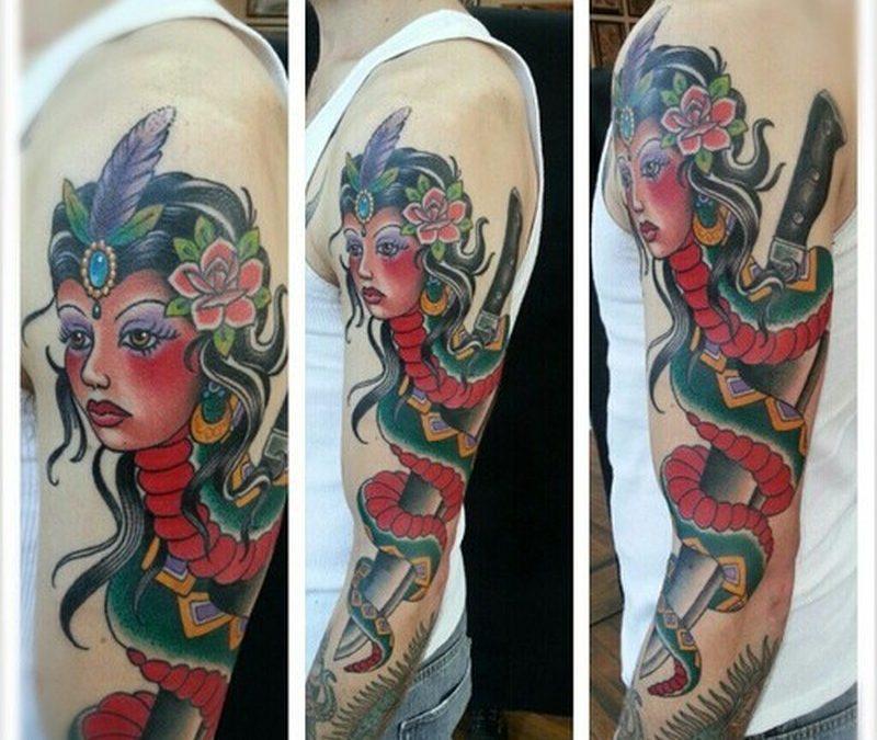 Gypsy head snake dagger on sleeve tattoo