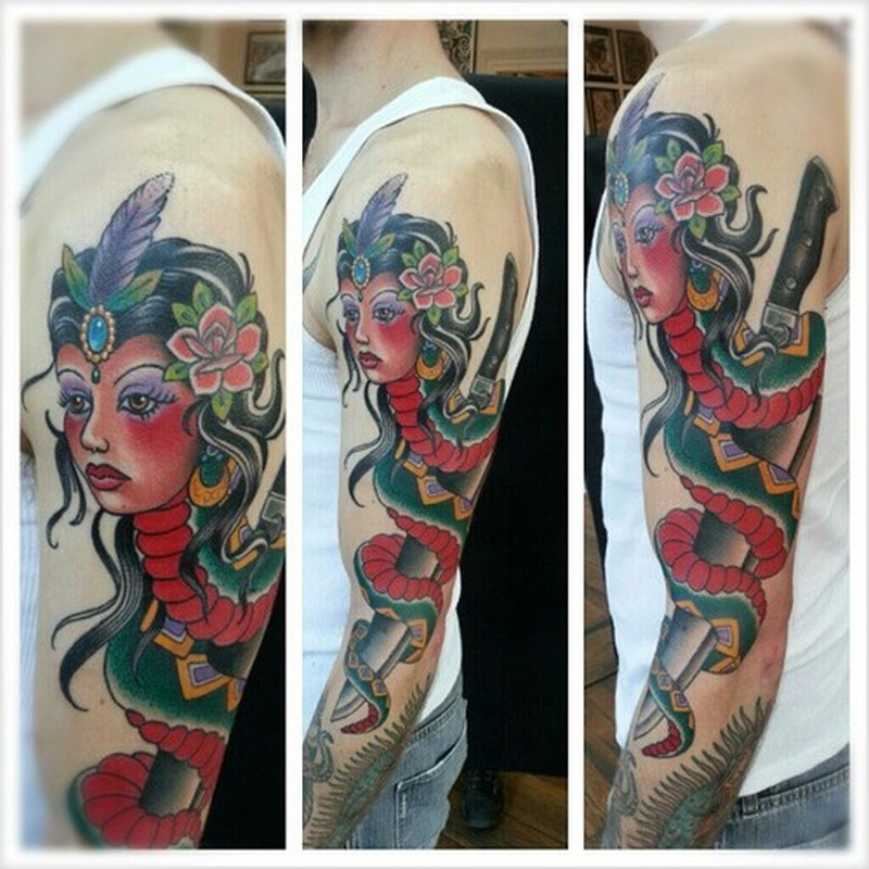 Gypsy head snake dagger on sleeve tattoo