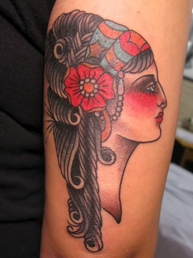 Gypsy head tattoo on elbow
