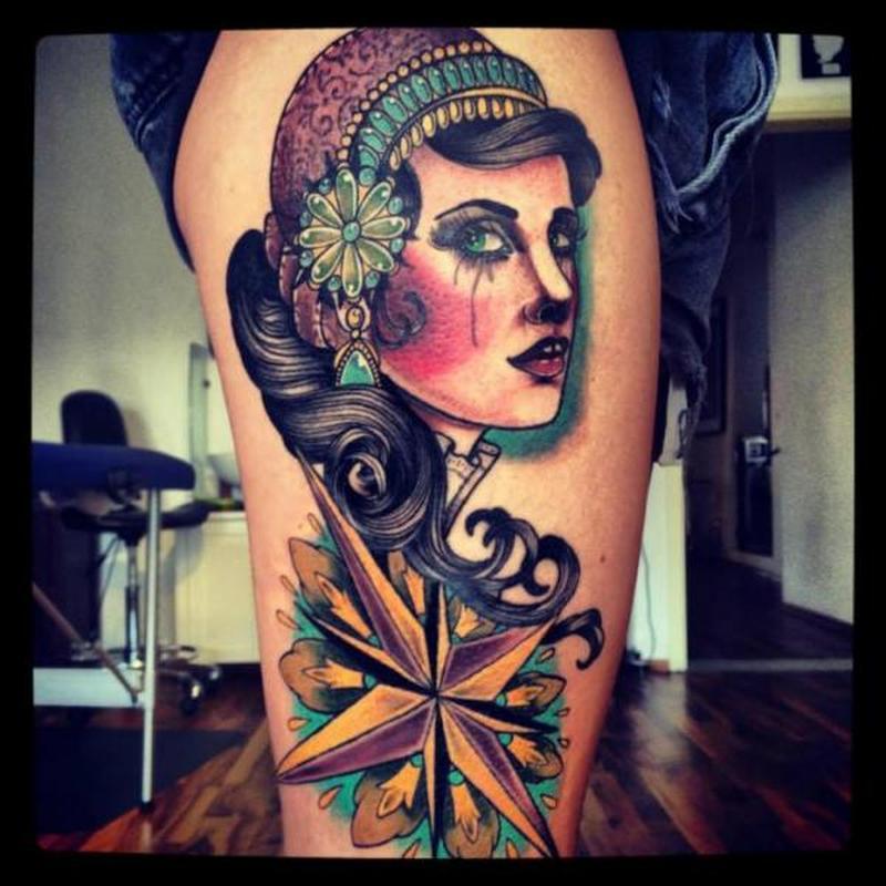 Gypsy n nautical compass tattoo on thigh