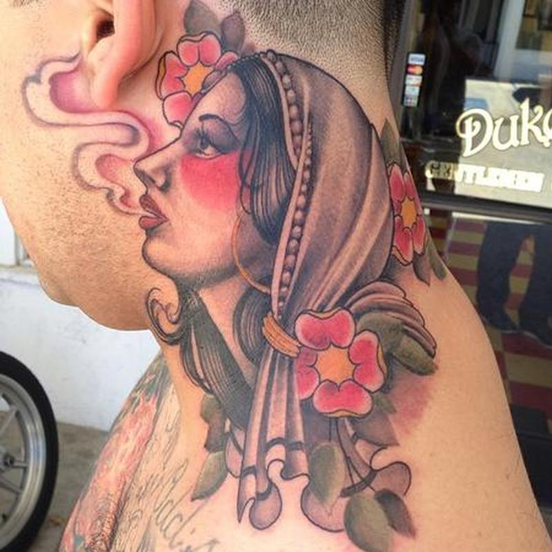 Gypsy tattoo on neck for women
