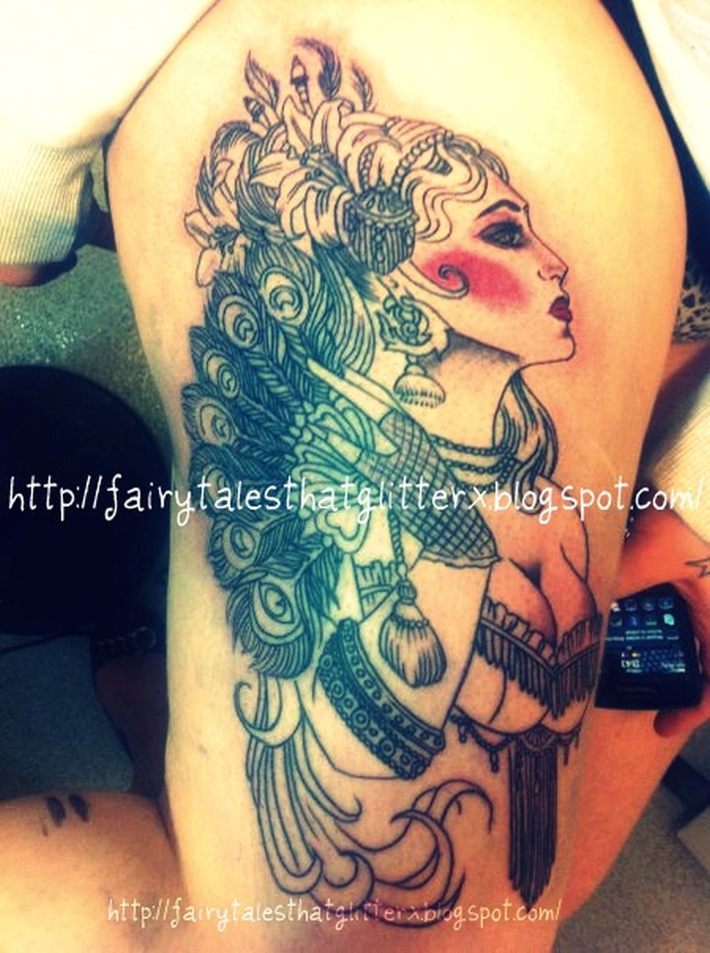 Gypsy tattoo picture on right thigh