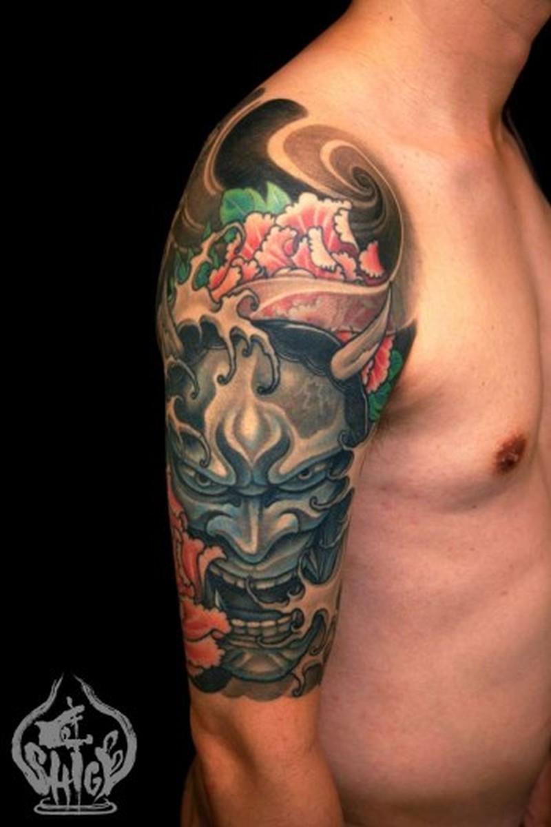 Half sleeve asian devil face tattoo