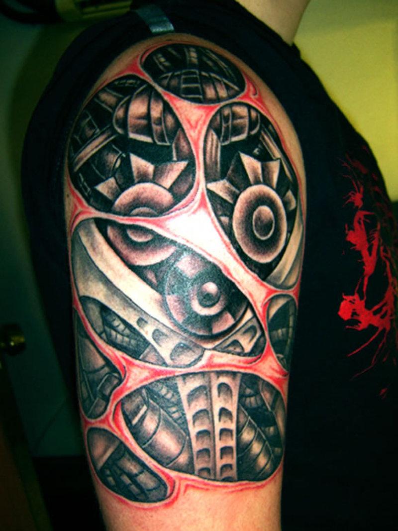 Half sleeve biomechanical alien tattoo