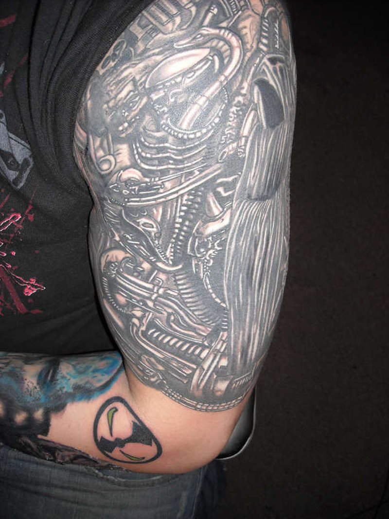 Half sleeve biomechanical design tattoo