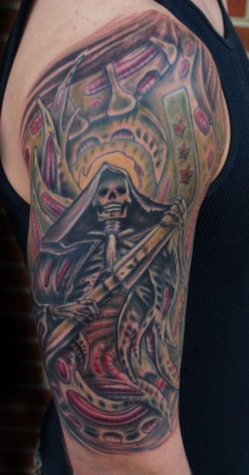 Half sleeve biomechanical grim reaper tattoo