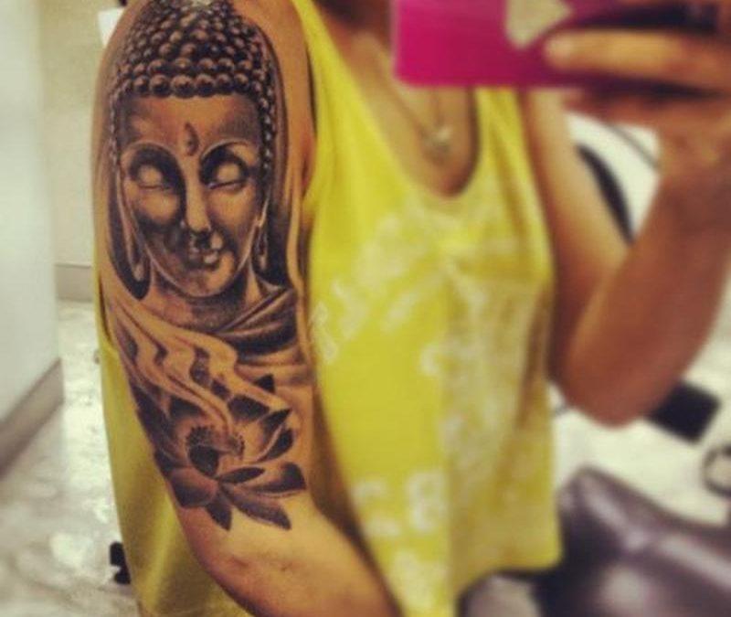 Half sleeve buddha head lotus tattoo