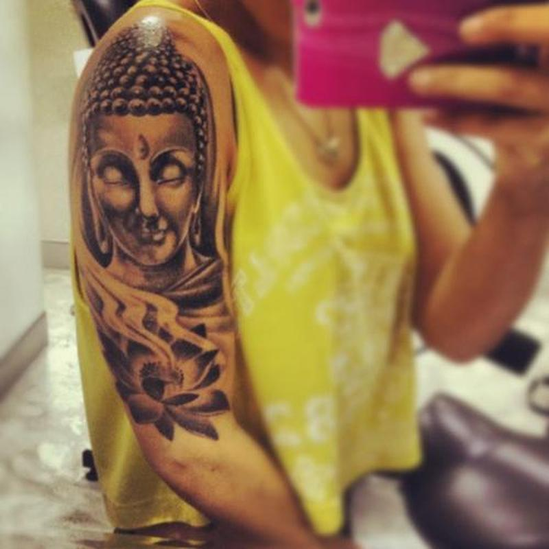 Half sleeve buddha head lotus tattoo