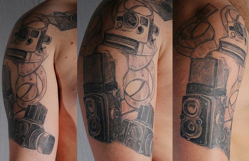 Half sleeve camera tattoo design for men